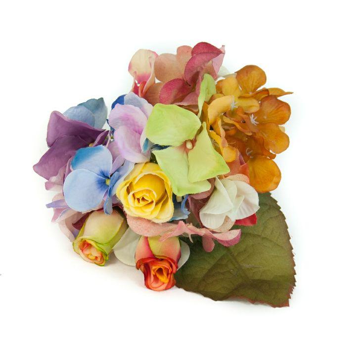 Ramillete de flamenca de flores silvestres en tonos ocres, azules y malvas.
