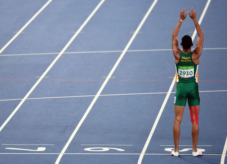 Wayde Van Niekerk (RSA) reacts after winning the men's 400-meter final. - John…