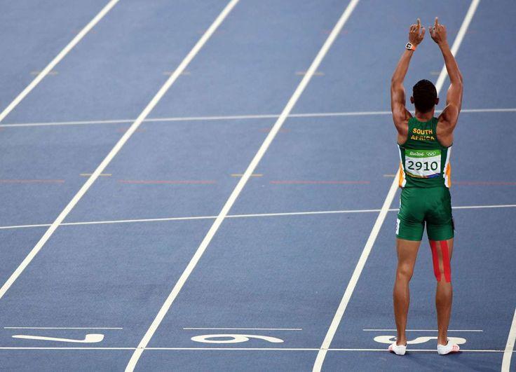 Wayde Van Niekerk (RSA) reacts after winning the men's 400-meter final. - John…