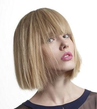 A Medium Blonde straight multi-tonal defined-fringe choppy womens haircut hairstyle by Tchip Coiffure