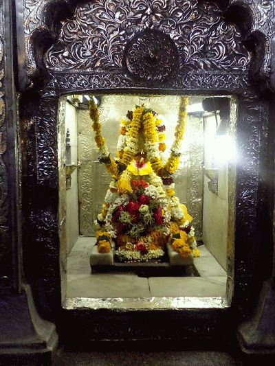 """EKNATH MAHARAJ'S SAMADHI AT PAITAN(PRATHISTANAPURAM)Eknath Maharaj lived for about 64 years in this world.  He along with his wife took """"jala Samadhi""""(they walked into Godavari river) and disappeared informing his followers that on the third day, they would find a banyan leaf and a Tulasi leaf floating on the river and advised them to build a Samadhi for him at the place where the leaves float."""