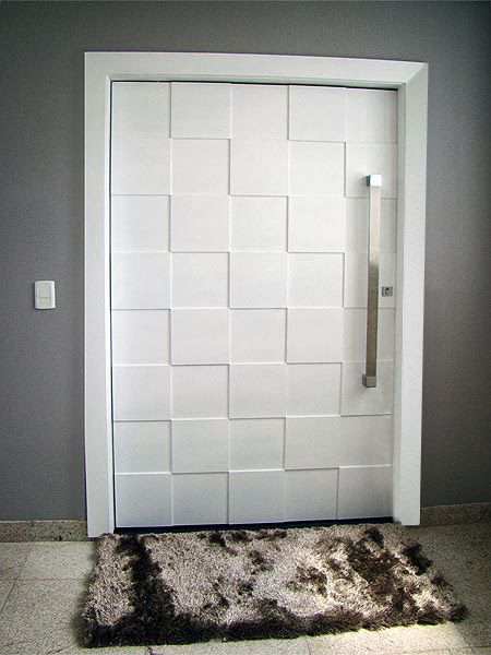 We love the eye-catching, 3-dimensional, geometric pattern on this pivot door in Brazil. We can custom build this exact door, OR one of your own custom designs at http://pivotdoorcompany.com/Exterior-Doors/.