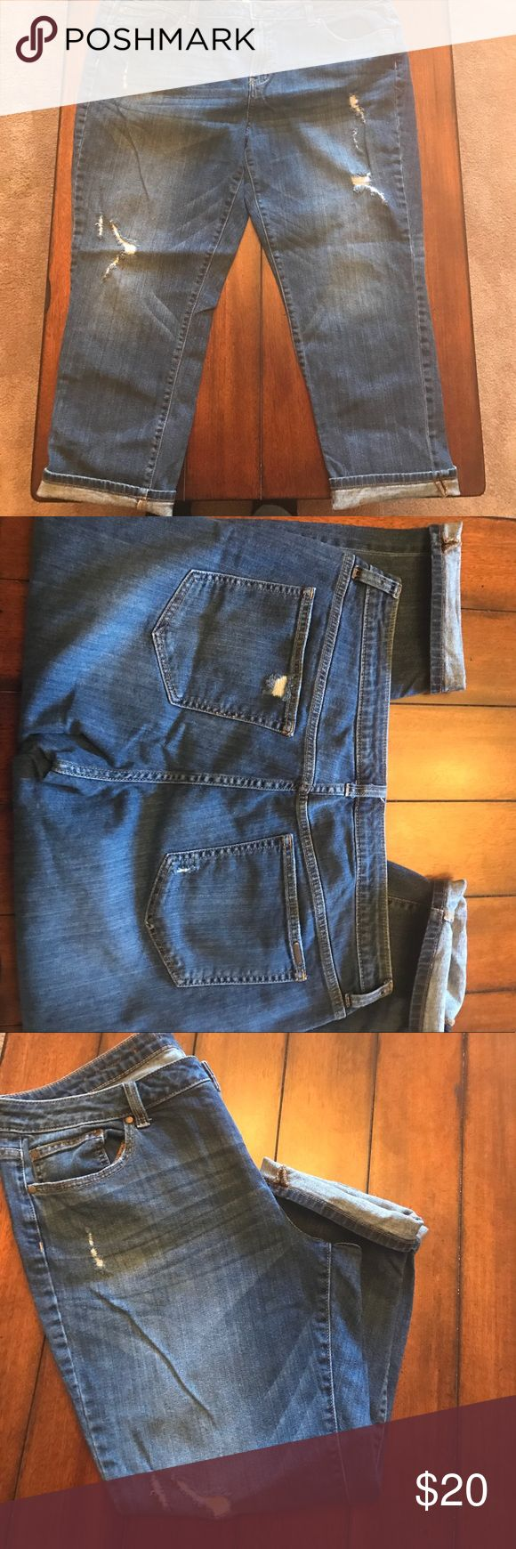 Jennifer Lopez Slim Boyfriend Jeans Super Cute Boyfriend Jeans in a medium wash with distressing on the legs and back pockets. No stains from a smoke free home. In excellent condition. Jennifer Lopez Jeans Ankle & Cropped