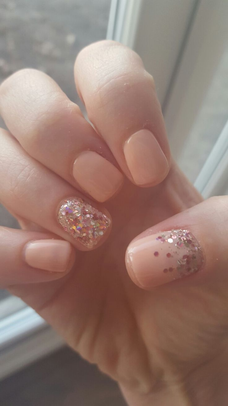 Nude gel polish nails with rose gold glitter