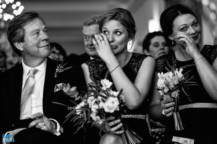 Emotional bridesmaids during the ceremony at a Spring Wedding at Coombe Lodge
