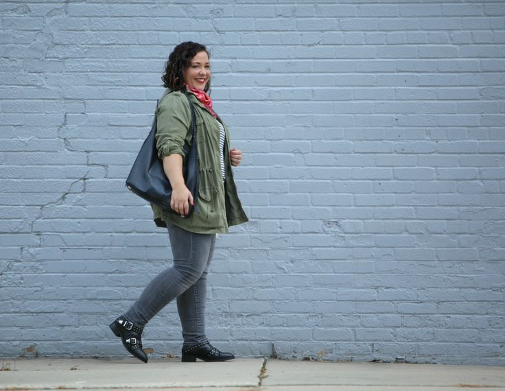 Wardrobe Oxygen in a green utility jacket with grey skinny jeans and an ALLSAINTS tote