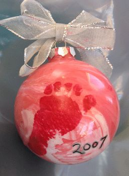personalize the ornament with your baby's tiny foot or hand print.  Footprints are typically easier to pull off, since you have more control over them.  You can use paint or water slip decals.  Water slip decals are a fun and different way to add images to glass.  If you are using water slip decals, you can scan your baby's hand or footprint and then print it out on the decal.