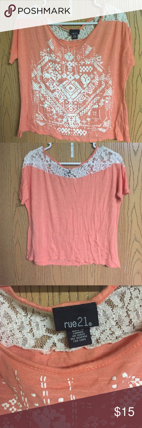 Rue 21 orange Aztec tee Orange tee with white Aztec design on the front. Lace across the top from sleeve to sleeve Rue 21 Tops Tees - Short Sleeve