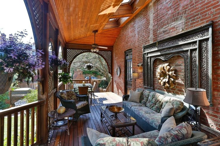 Eclectic Porch with Fence, outdoor pizza oven, Glass panel door, Screened porch