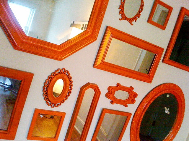 Maybe on an orange wall with a reddish colored paint on the frames?
