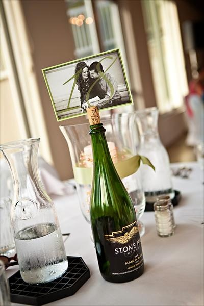 Table number AND picture holder :) this would be perfect with the bottle of wine that we are specially making for our wedding.