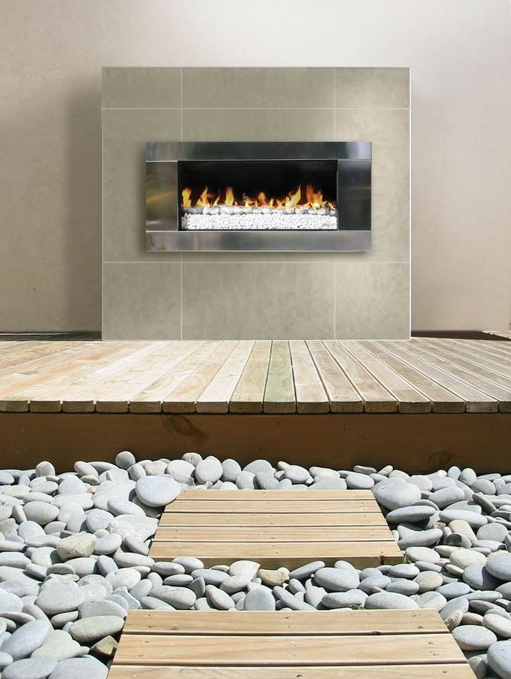 Escea EF5000 outdoor gas fireplace with white coals.