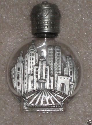 The twin towers - the lid is heavy matter silver pewter and the New York City skyline features such famous landmarks as the Chrysler Building, the Empire State Building, and the World Trade Center Twin towers.