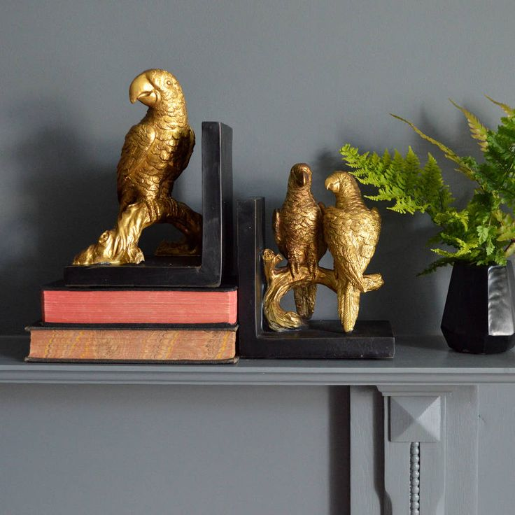 Stunning gold parrot bookends.These gold parrot bookends give your home décor that touch of the oriental. Three cheeky parrots perched on branches painted in old gold contrasts beautifully with the black and make a real statement on your bookshelves. Or use these gold parrot bookends individually as decorative objects in their own right.Polyresin  H22 x W15 x D12cm