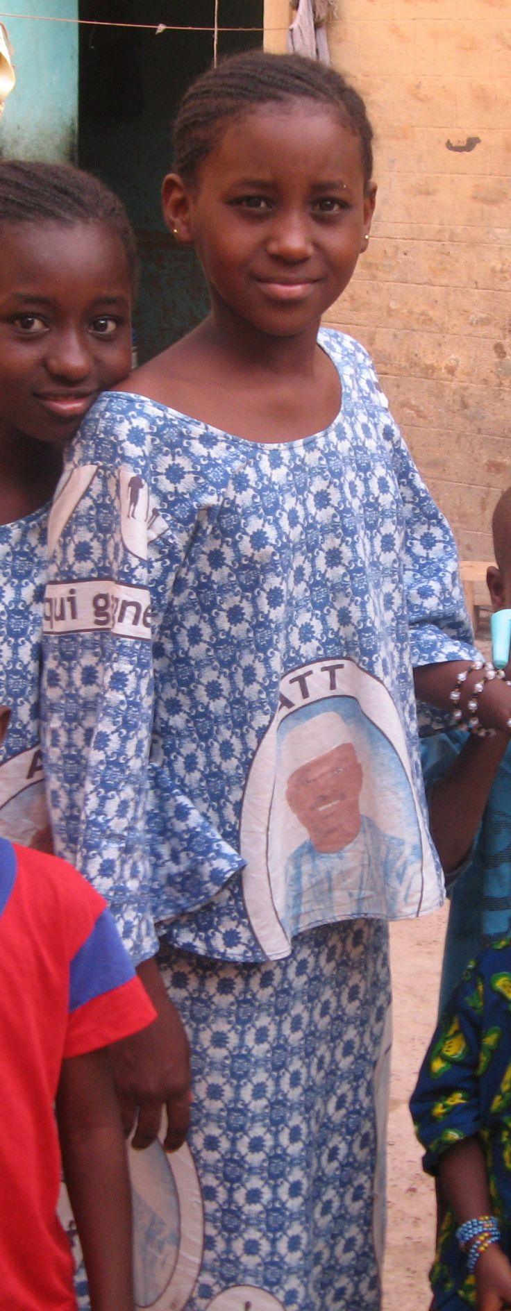 Malian girls wearing dresses made from campaign fabric from President Amadou Toumani Toure's 2007 re-election