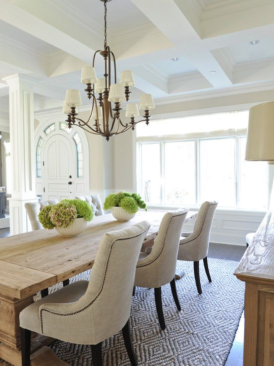 Classic coastal dining room with beamed ceiling, rustic table, sand tones throughout