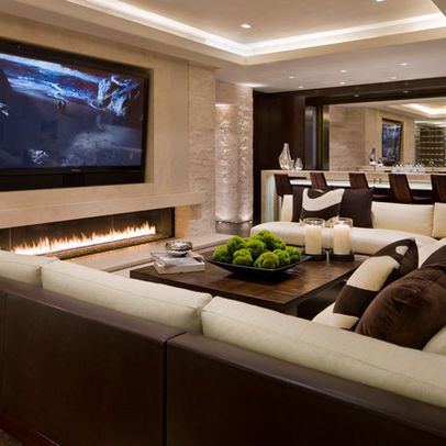 that wall! Tv, stone wall..... and that crazy sick linear fireplace! Very cool