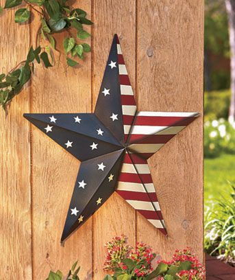 "Put the 24"" Americana Star Decor on display all year long in your home or garden. The large-scale barn star is decorated with an American-themed design, perfect for outdoor use. Use the 7"" stakes to install it into the ground, or use the included jute ro"
