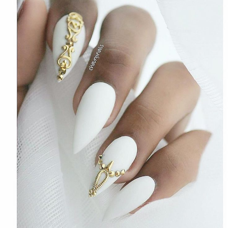 White Stiletto Nails With Gold Accents
