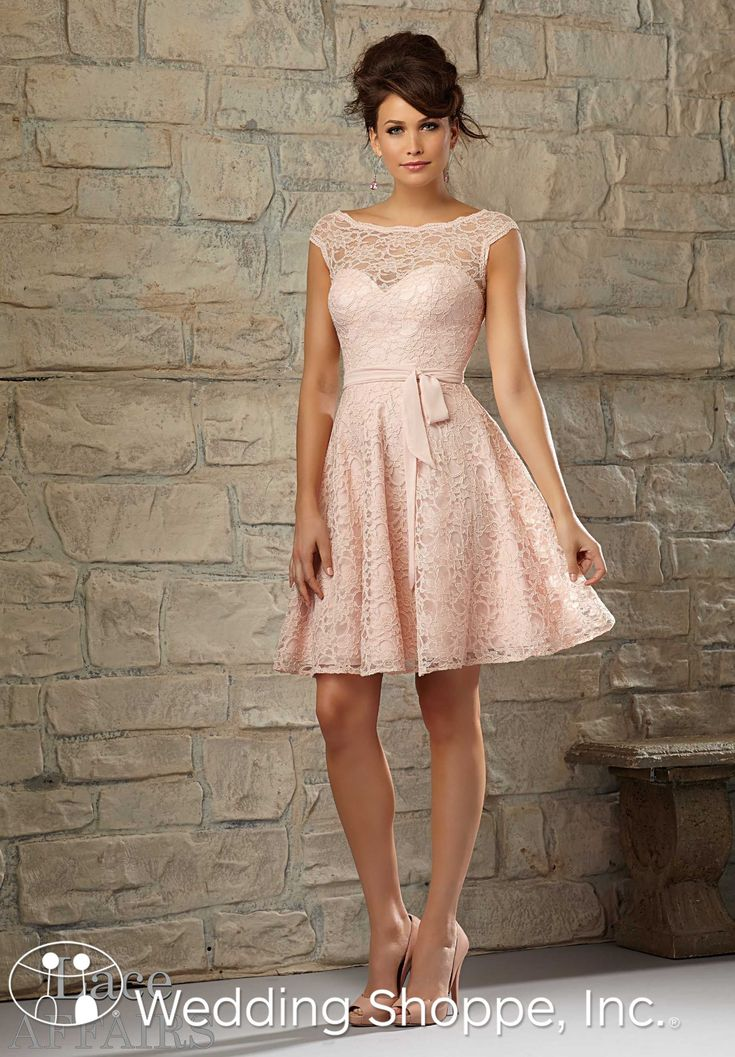 Beautiful illusion neckline lace bridesmaids dress in blush.