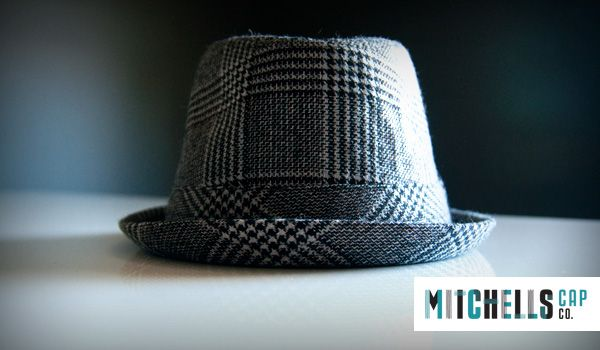 Fedora hat with a narrow peak and jacquard printed wool fabric. Stylish hounds tooth 'David Jones' print.