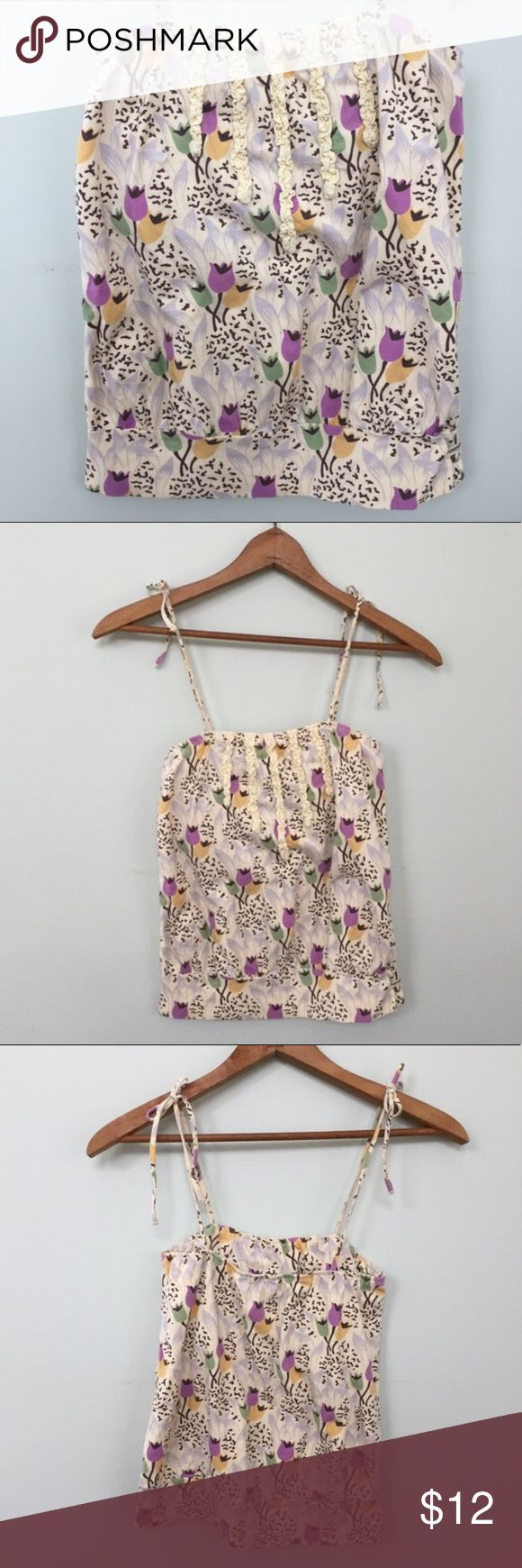 American Eagle | AE Tulip Print Floral Tank Straps tie at shoulders and adjustable. Very versatile - I have worn it as a halter, tube top or tying over the shoulders. Built in shelf bra. American Eagle Outfitters Tops