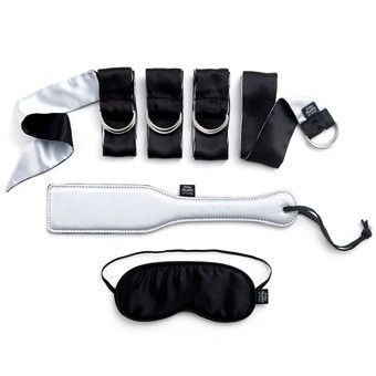 Fifty Shades of Grey Submit to Me Beginners Bondage Kit (6 Piece) Reference:  FSOG40184 Condition:  New product  Including everything you need to bring the adventures of Ana and Mr Grey to life, this kit is a must-have for novice bondage players. With 4 x satin restraints, blindfold, and padded spanking paddle, you're on your way to creating your very own playroom.
