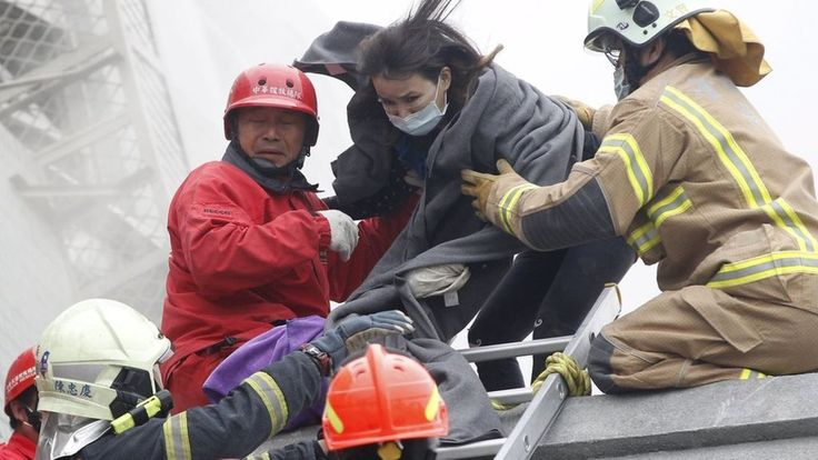 Rescuers search for trapped survivors after an earthquake topples buildings in the south Taiwanese city of Tainan, killing at least 11 people.