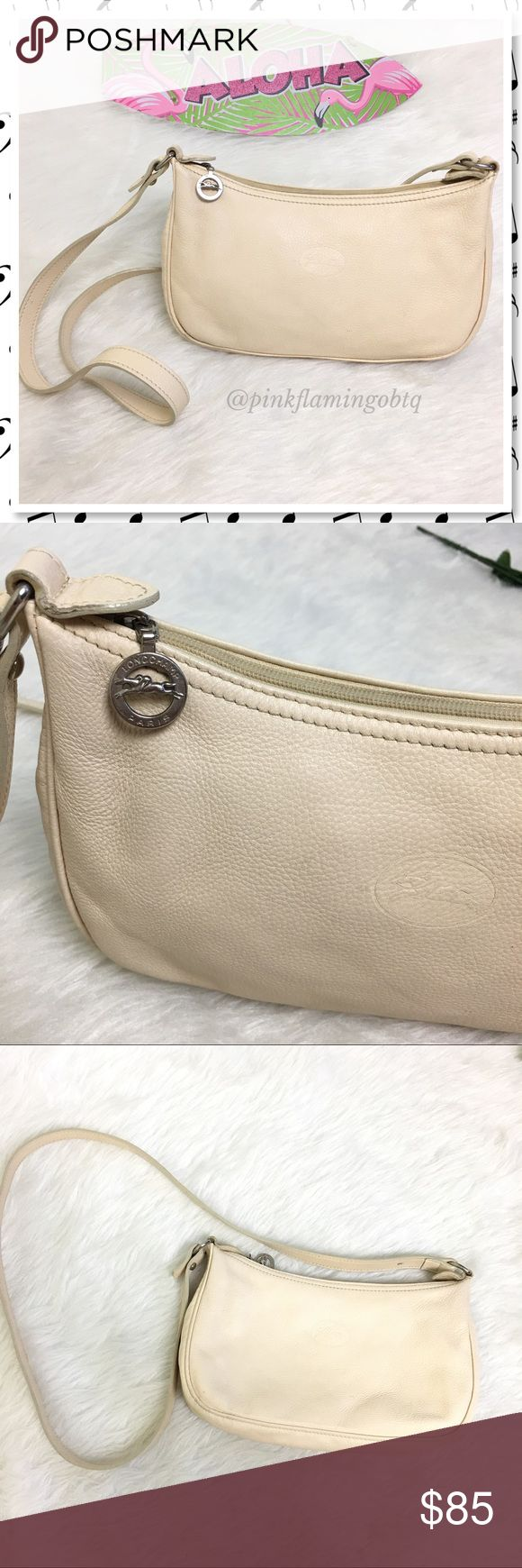 Vintage Longchamp Beige Pebbled Leather Crossbody Vintage Longchamp buff beige pebbled leather crossbody purse. One interior compartment with an open slip pouch to keep loose items separate. All lined in Longchamp fabric. Adjustable strap that can be worn crossbody or shoulder bag. Logo metal key fob zip pull. Beautiful vintage purse! Tiny flaws have been photographed and are not too noticeable considering the bags age. Perfect for any Longchamp collector or fan! Longchamp Bags Crossbody…