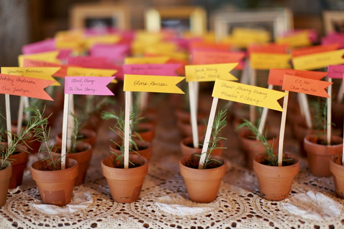 lovely rosemary potted plants as winter wedding favors double as escort cards - smart