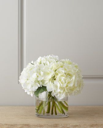 white hydrangea centerpiece - short cylindrical vase