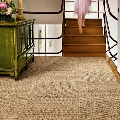 Coming Along carpet squares have the familiar look of woven sea grass but in earth-friendly fibers that make them softer and easier to maintain.