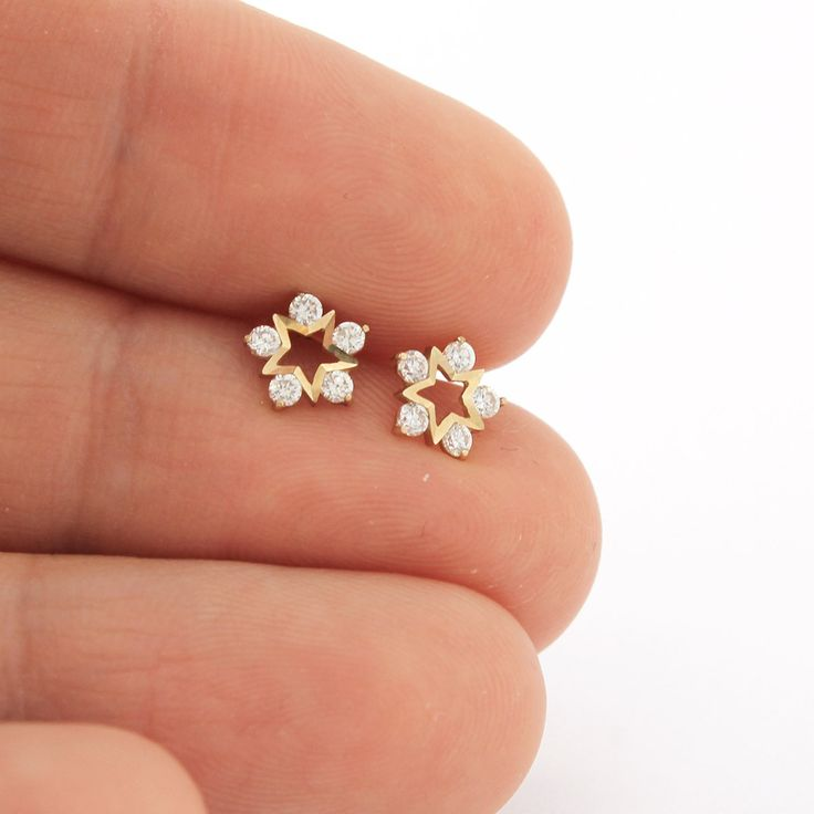 These earrings are made of solid 14k gold (available in white or yellow gold) and diamond-simulated cubic zirconia stones (cz), which shine and sparkle beautifully. Earrings measures 6 x 6 mm. Posts a