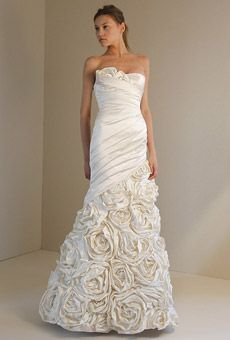 Fabulous adding fabric roses to a wedding gown