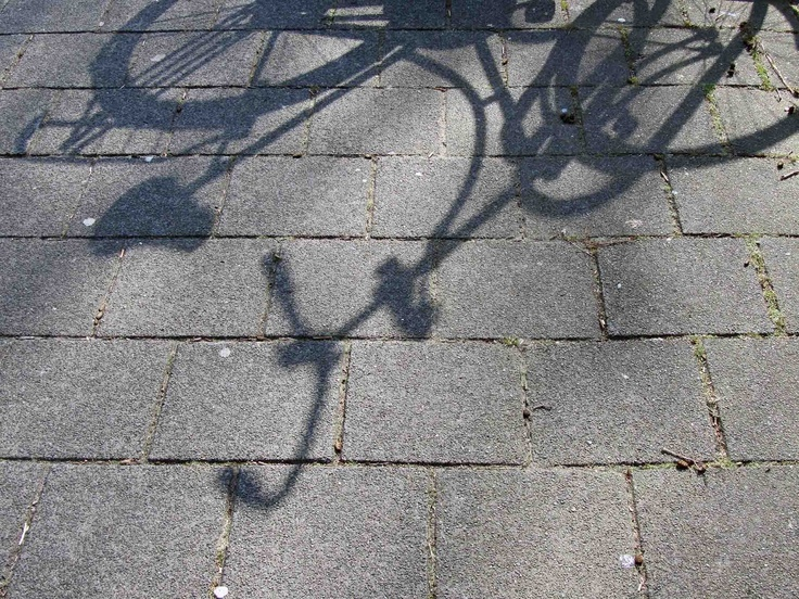Shadow of a parked bike.