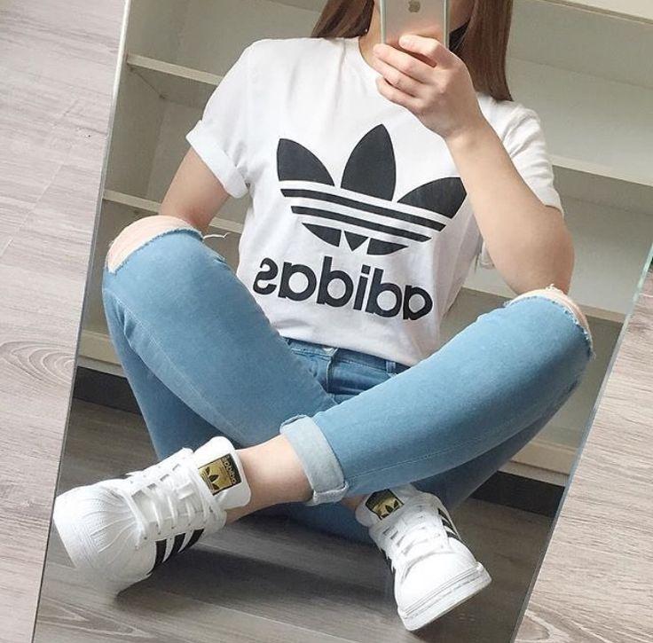 White Adidas shirt, knee ripped jeans, white adidas superstars