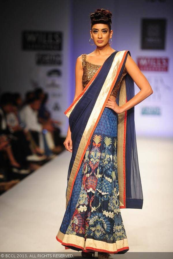 Binal displays a creation by fashion designers Ashish Viral and Vikrant on Day 5 of Wills Lifestyle India Fashion Week (WIFW) Spring/Summer 2014, held in Delhi.