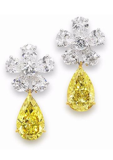 A Pair Of Diamond Cer Earrings By Graff Each Pear Shaped Fancy Deep Yellow Weighing 2 53 And 35 Carats Suspende
