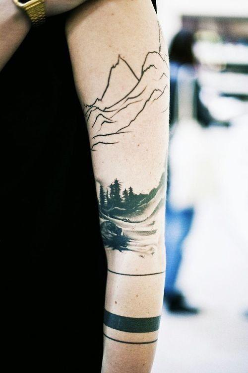 black work tattoo male arm