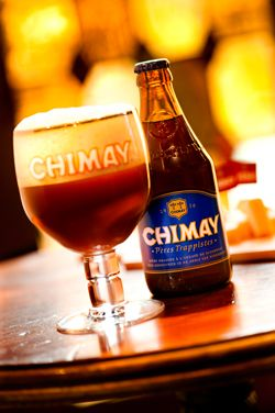 """The Chimay Blue Cap ~   """"Grande Reserve"""" in 750 ml bottles is a dark Trappist beer with a powerful aroma, the complex flavor of which improves across the years. It was first brewed as a Christmas beer, explaining the presence of a """"vintage"""".    This authentic Belgian beer, whose tinge of fresh yeast is associated with a light rosy flowery touch, is particularly pleasant. Its aroma, perceived as one enjoys it, only accents the delightful sensations revealed by the odour, all revealing a…"""