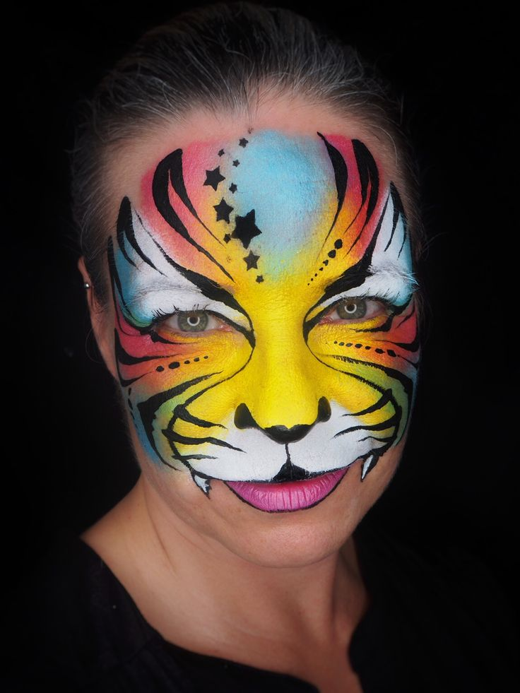 Colourful tiger face paint inspired by Olga Murasev.
