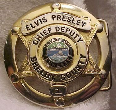 Elvis belt buckle. Memphis is located in Shelby County TN.