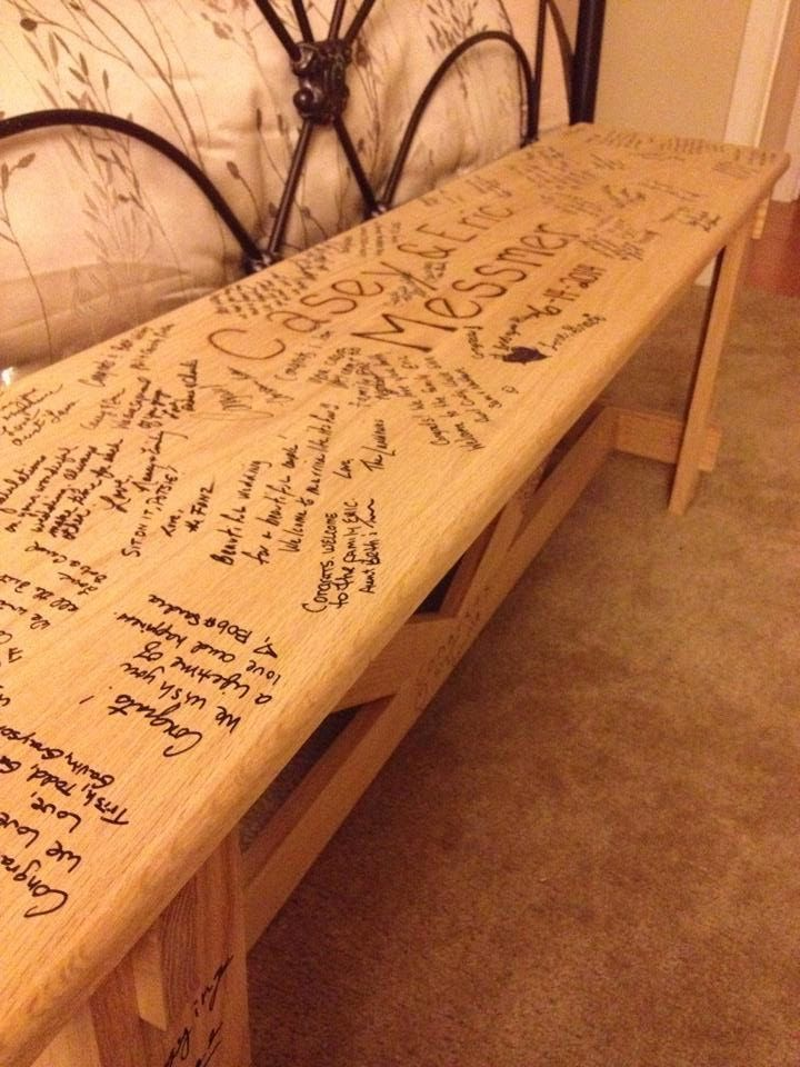 A bench signed by all the guests at the wedding. The bench was our guest book. This was a great wedding gift!