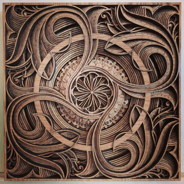 Cut Plywood Relief Sculptures Embedded with Mandalas and Geometric Patterns by Gabriel Schama