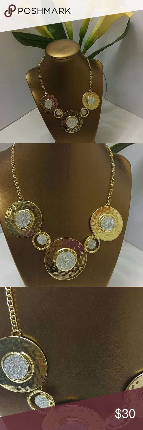 Classy Statement Necklace Add some life to that neckline...🙆..This adorable piece is full of life and class..gold plated an excellent quality piece.accented with gold dust in each piece of nicely  shaped oval which makes this stands out.It comes with a perfectly paired  earring..💃💃💃 Lake shore Drive Jewelry Necklaces