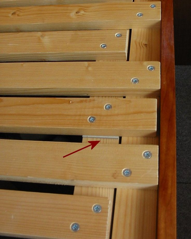 Packing under longer slat to ease sliding. http://deepredmotorhome.com/bed.php