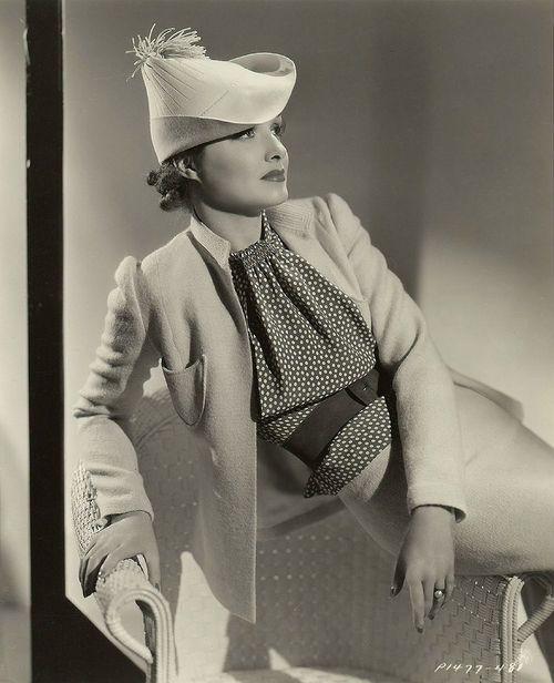1930's fashion ensemble. Gail Patrick, 1936. Hat, jacket, polkadot blouse, waist belt.