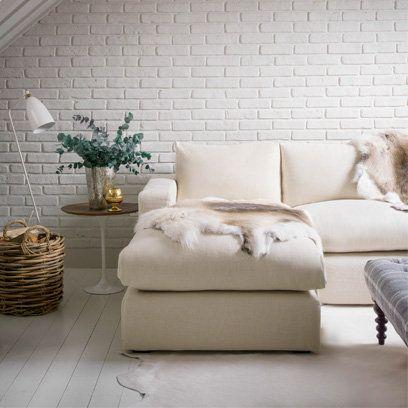All white living roomm, animal skin rug