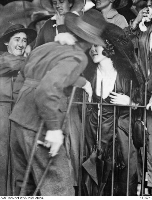 A wounded AIF soldier receives an affectionate welcome home at the Anzac Buffet in The Domain, Sydney, 1918