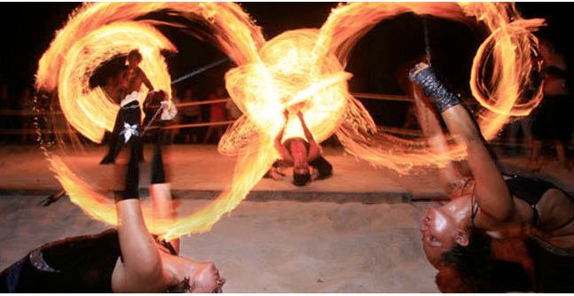 Fire Show at Blue Parrot Beach Club-Playa del Carmen, Mexico...bar has swings to sit in instead of bar stools..so amazing.